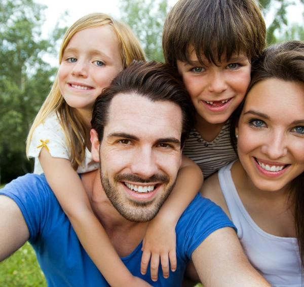 Happy-Young-Family-Taking-Self